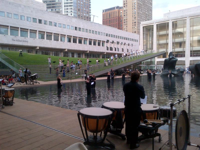 During a performance of John Luther Adams' new work, 'Sila,' on the Lincoln Center campus, musicians play in knee deep water using 19th-century-style 19th century amplification: megaphones.