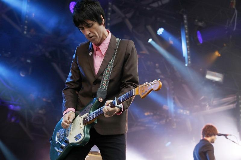 In this Aug. 1, 2014 file photo, British singer Johnny Marr performs at Camp Bestival at Lulworth Castle in Dorset, England.