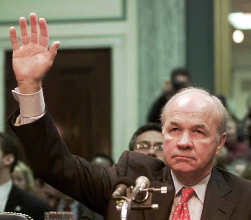 Former Enron CEO Kenneth Lay is sworn in at a Senate Commerce Committee hearing on Capitol Hill in a 2/12/2002 file photo in Washington.  Lay was convicted 5/25/2006 of all 6 counts against him.