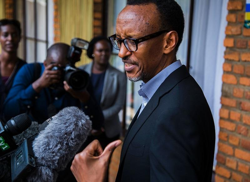 Rwandan President Paul Kagame speaks to journalists after voting in Kigali on December 18, 2015 in a referendum to amend the constitution allowing him to rule until 2034.
