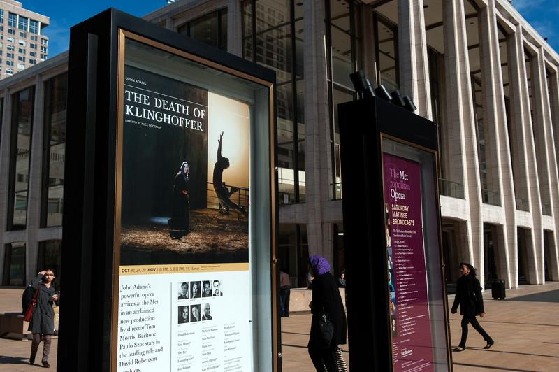 Signs promote 'The Death of Klinghoffer' outside the Metropolitan Opera at Lincoln Center on October 20, 2014 in New York, NY.