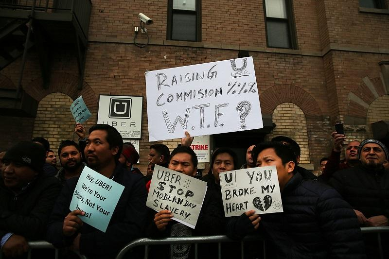 Uber drivers protest the company's recent fare cuts and go on strike in front of the car service's New York offices on February 1, 2016 in New York City.