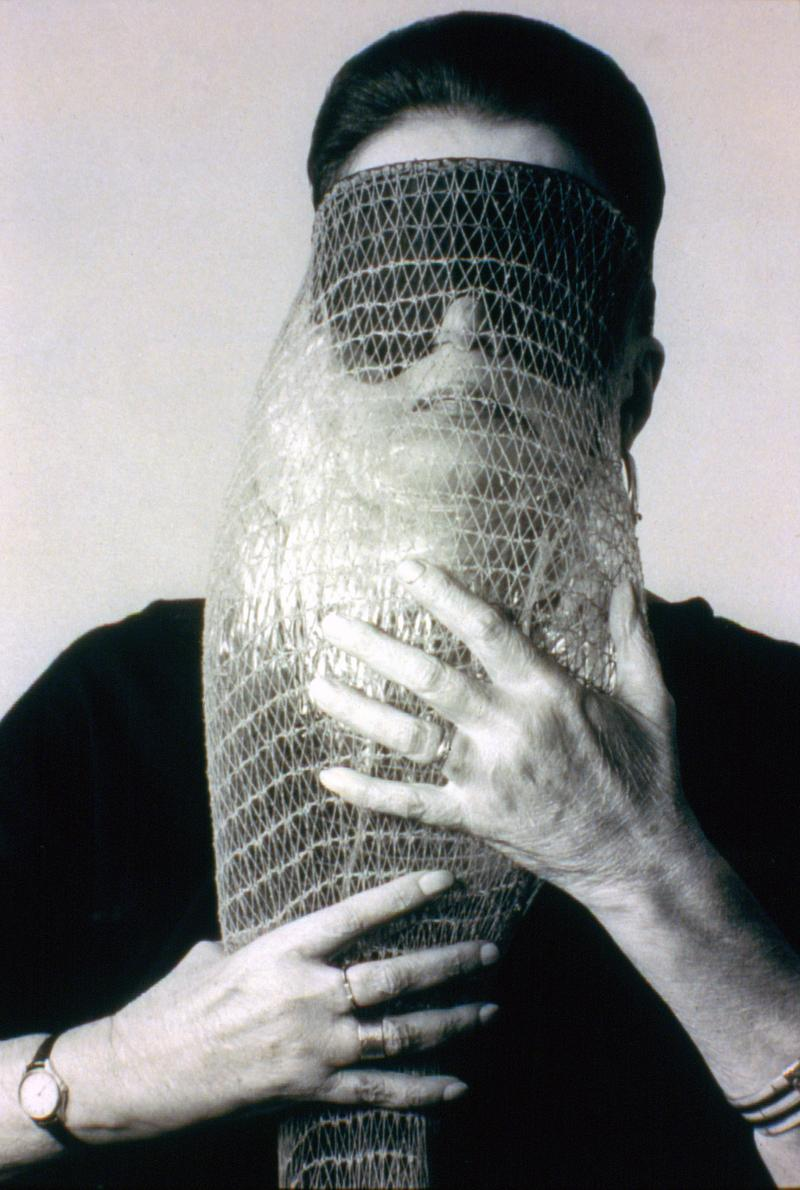 Lygia Clark wearing Máscara abismo com tapa-olhos (Abyssal mask with eye-patch, 1968)