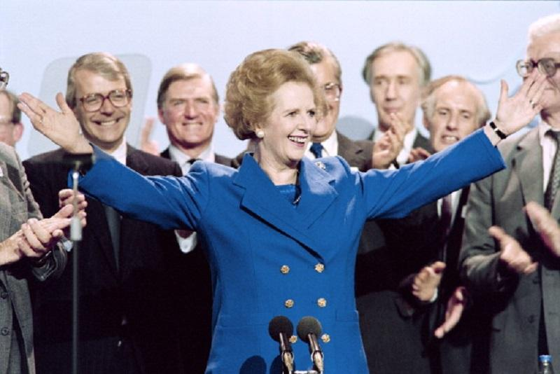 British Prime Minister Margaret Thatcher acknowledges applauds on Ocotber 13, 1989 at the end of the Conservative Party conference in Blackpool.