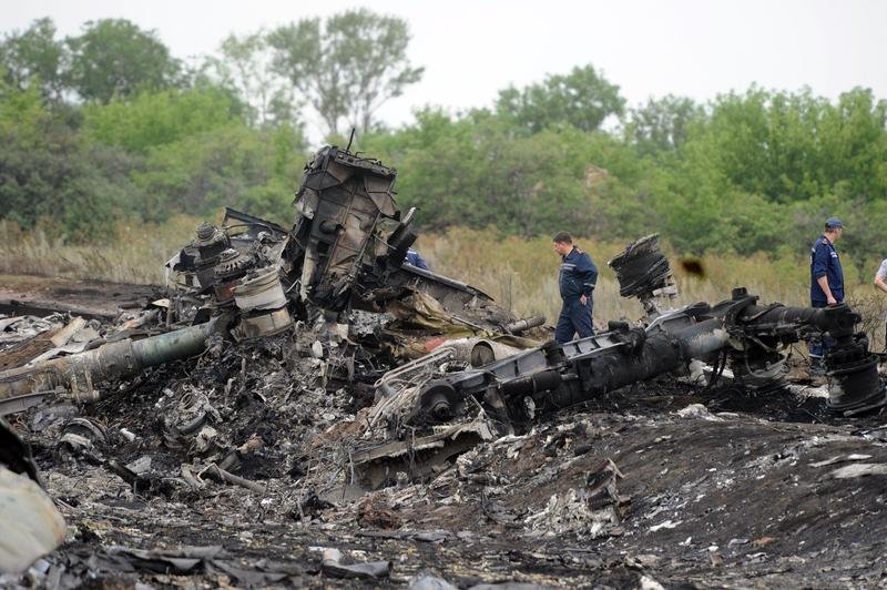 Rescuers stand on July 18, 2014 on the site of the crash of a Malaysian airliner carrying 298 people from Amsterdam to Kuala Lumpur, near the town of Shaktarsk, in rebel-held east Ukraine.