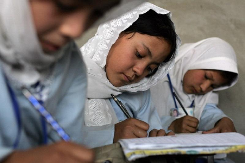Young Afghan girls work on their studies during class Tuesday, August 29, 2006 at the Marefat School in Kabul.