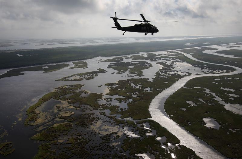 A Louisiana National Guard blackhawk flies over marshland on April 19, 2011 in route to Middle Ground in southern Louisiana.