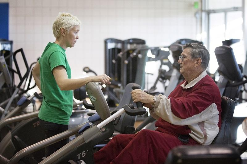 In this photo taken Dec. 22, 2015, Glendon Bassett right, visits with Tamara Hess-Adams team leader of the fitness center at the Family YMCA in Hot Springs, Ark.