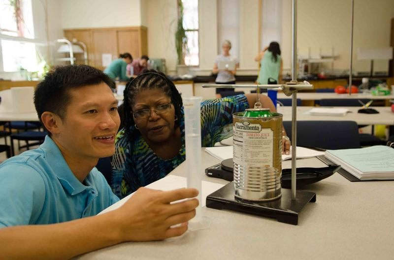 Science teachers conduct an experiment in a workshop on Modeling Instruction at Columbia's Teachers College.
