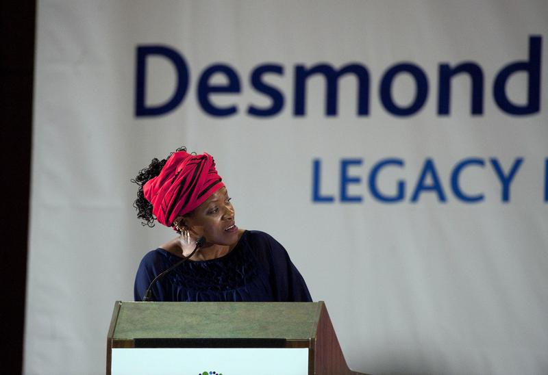 Reverend Mpho Tutu, daughter of Archbishop Desmond Tutu looks across at her father before the third annual Desmond Tutu International Peace Lecture, on October 7, 2013.
