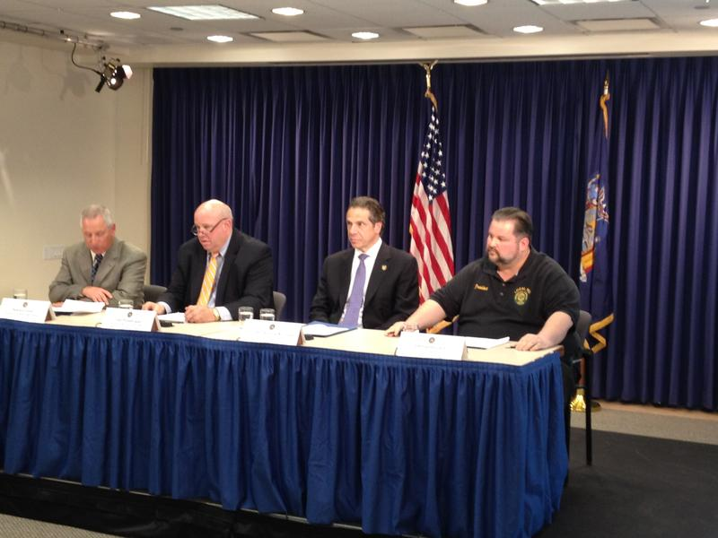 MTA chairman Tom Predergast, Governor Andrew Cuomo, and TWU Local 100 president John Samuelsen announcing a labor deal in April 2014