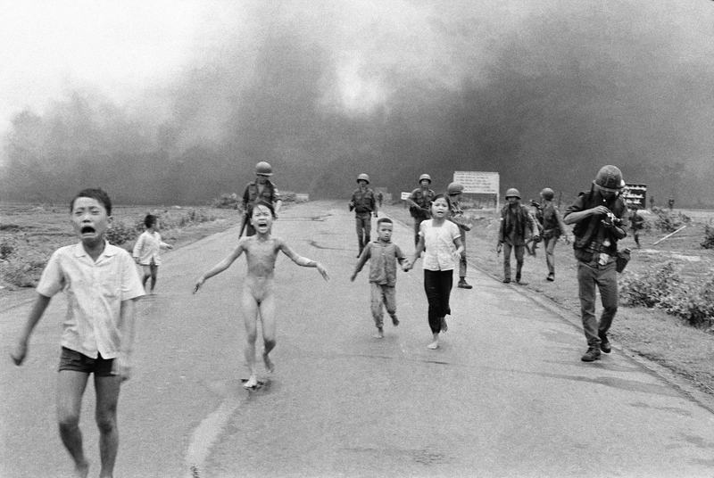 South Vietnamese forces follow after terrified children, including 9-year-old Kim Phuc, center, after an aerial napalm attack on suspected Viet Cong hiding places, June 8, 1972.