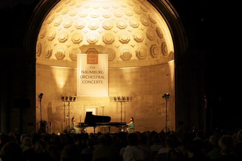 Twin sisters Christina and Michelle Naughton play at the Naumburg Bandshell in Central Park.