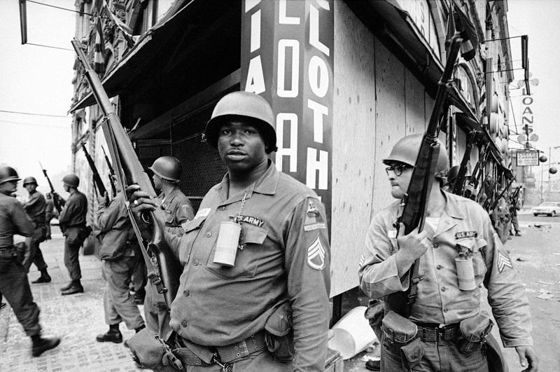 National Guardsmen patrol deadly area of Newark, July 14, 1967, after a Newark detective was shot in heart there by sniper's bullet.