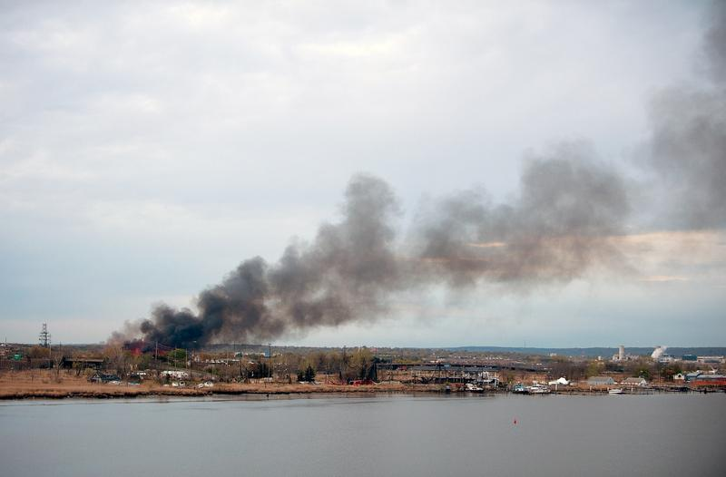 Smoke billows in the sky from a brush fire in the Meadowlands near Metlife Stadium on April 11, 2012 in Carlstadt, NJ.
