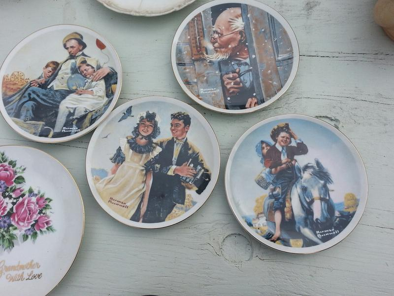 Norman Rockwell plates at a garage sale in Oakland.