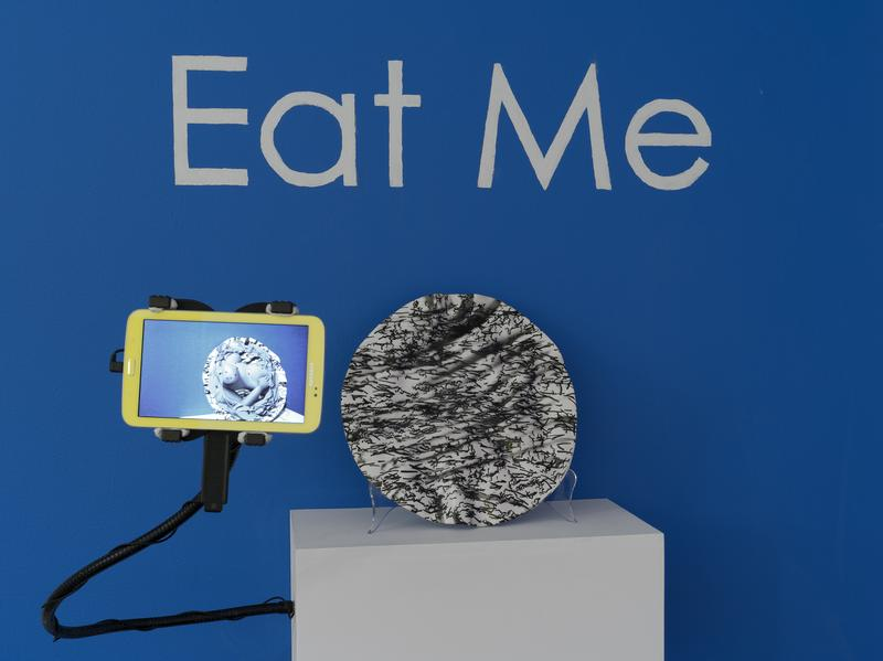 "Hand-thrown paper porcelain dish with a video display of ""augmented reality"" created by artist Claudia Hart."