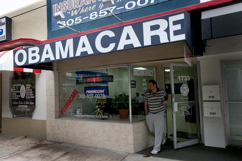 Baseel Farah walks out of Leading Insurance Agency as the insurance agency helps enroll people in health insurance plans under the Affordable Care Act on February 13, 2014 in Miami, Florida.