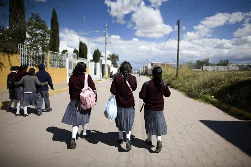 School children walk through the streets of the town of Rafael Lara Granjales, Mexico, Wednesday, Oct. 15, 2008.