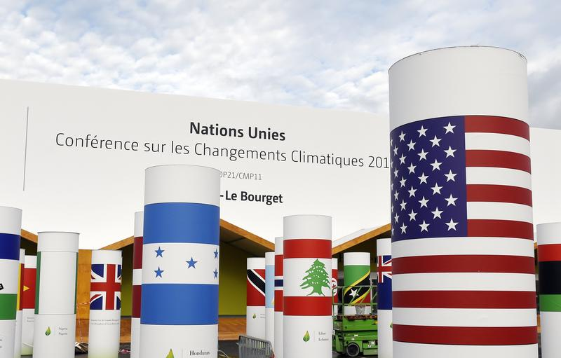 Pillars with the names and national flags of countries attending the COP 21, UN climate conference, decorate the outside of the venue hall.