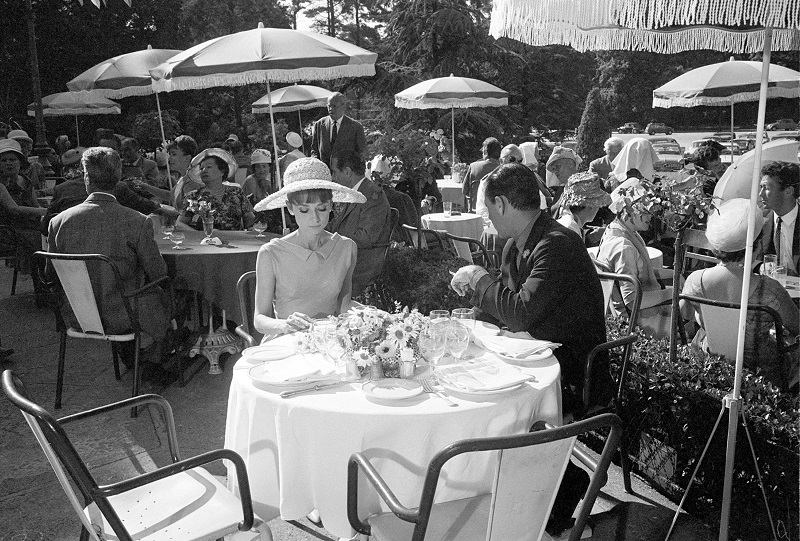 "Audrey Hepburn and William Holden sit at the Restaurant of the Cascade in the Bois de Boulogne in Paris, while filming a scene of the motion picture "" Paris When it Sizzles,"" on July 24, 1962."