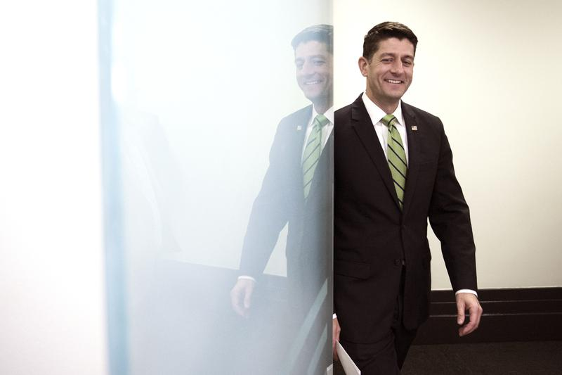 House Speaker Paul Ryan of Wis. is reflected in a glass door as he arrives to speak with reporters following the Republican Caucus meeting on Capitol Hill in Washington, Tuesday, May 2, 2017.