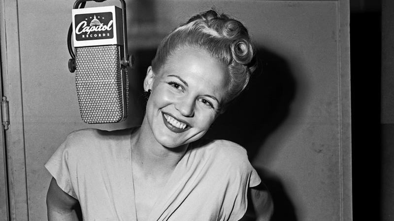 Peggy Lee records in the Capitol Records studios on April 10, 1946 in Los Angeles, California.