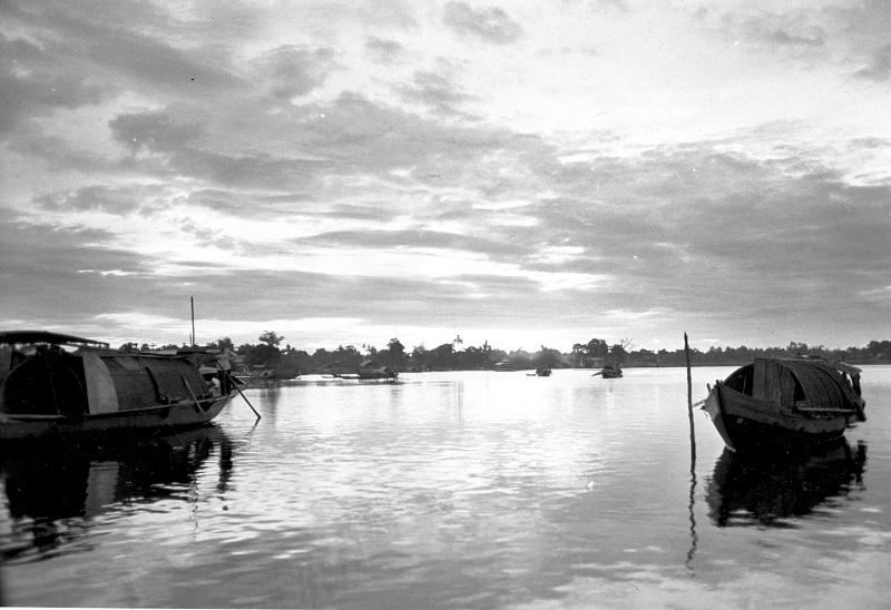 Sampans rest at their moorings on the Perfume River at sunrise, at Hue, South Vietnam, on June 21, 1971.