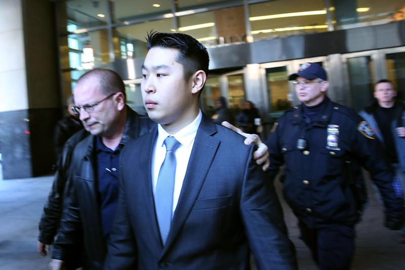 NEW YORK, NY - FEBRUARY 11: New York City police officer Peter Liang is escorted out of court after he was charged with manslaughter, official misconduct and other offenses.