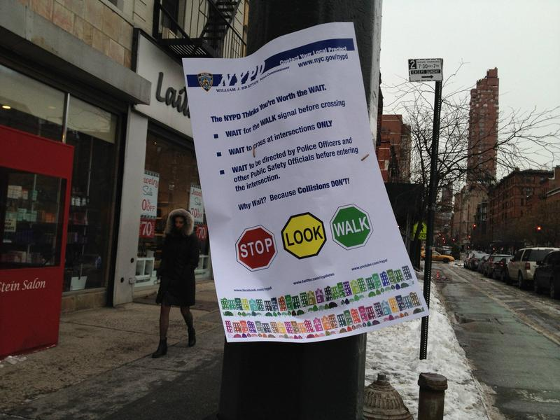 Signs warning pedestrians not to jaywalk on the Upper West Side