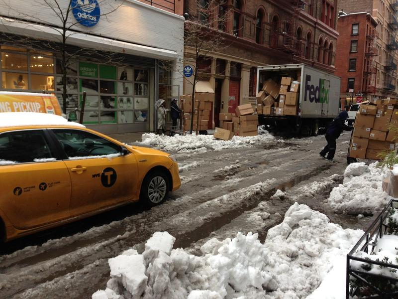 Deliveries on Prince Street in SoHo continued as usual despite icy puddles on the streets and sidewalks, February 5, 2014.