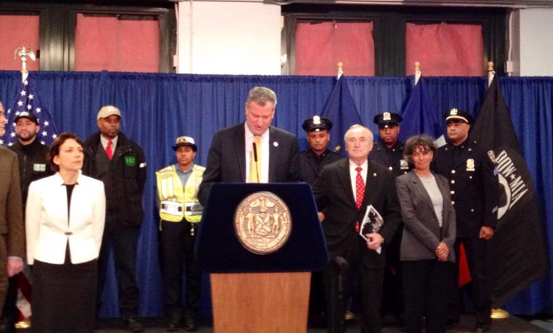 NYC Mayor Bill de Blasio, flanked by DOT commissioner Polly Trottenberg (L) and NYPD head William Bratton (R)