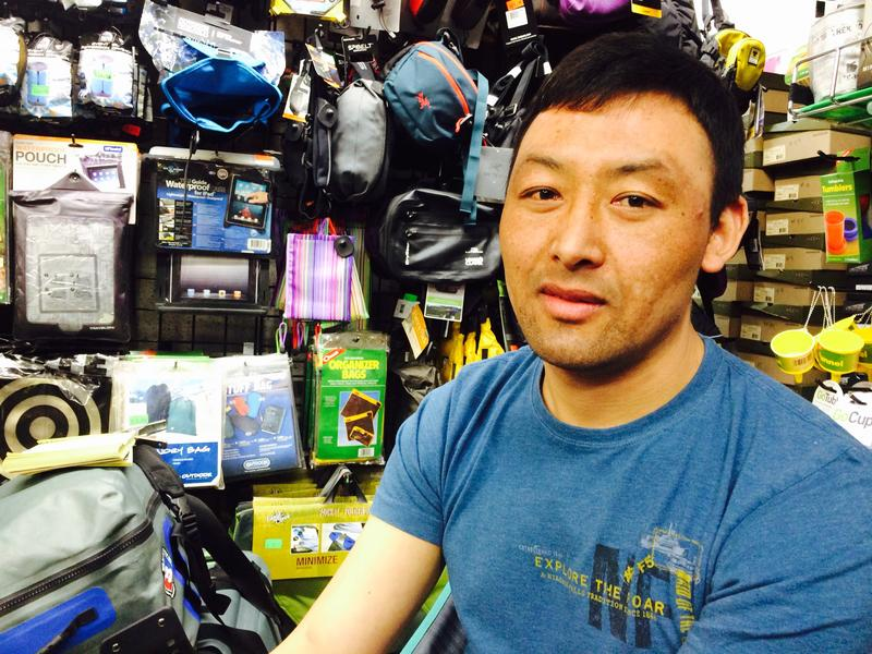 Passang T. Sherpa, a climber who also works at Tent & Trails, downtown. He is haunted by the deaths of Sherpas on Everest and fears his people are dying off.