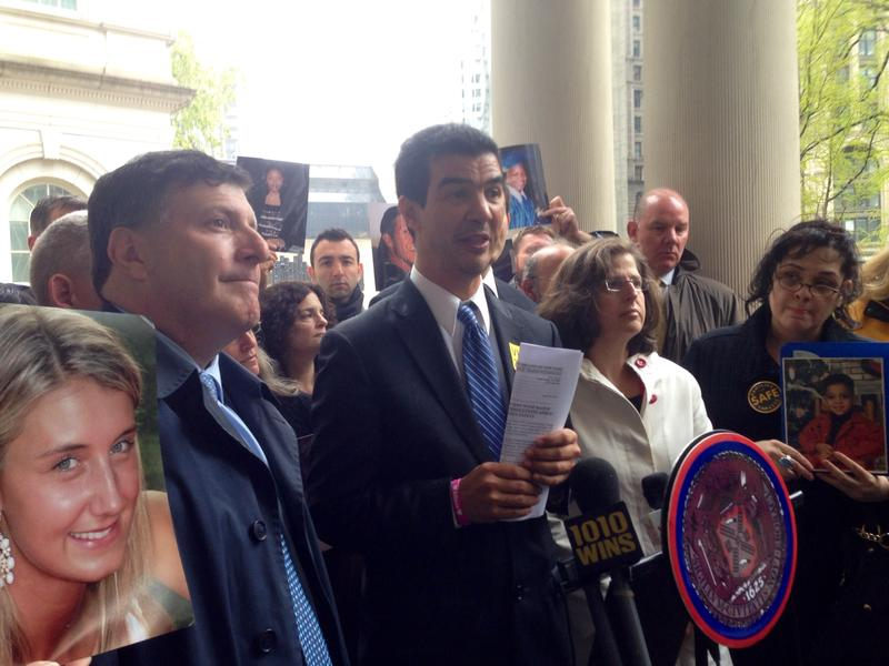 Councilmembers Mark Weprin, Ydanis Rodriguez and Helen Rosenthal, with Evelyn Cancel and other family members who lost loved ones in traffic crashes.