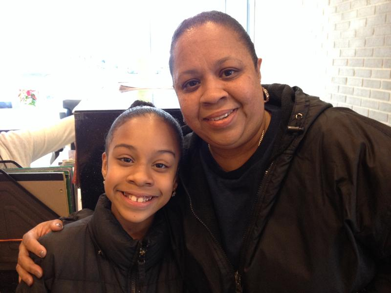 Thylia Rivera and her mother Evelyn Fuentes after a dentist  appointment that took less than half an hour