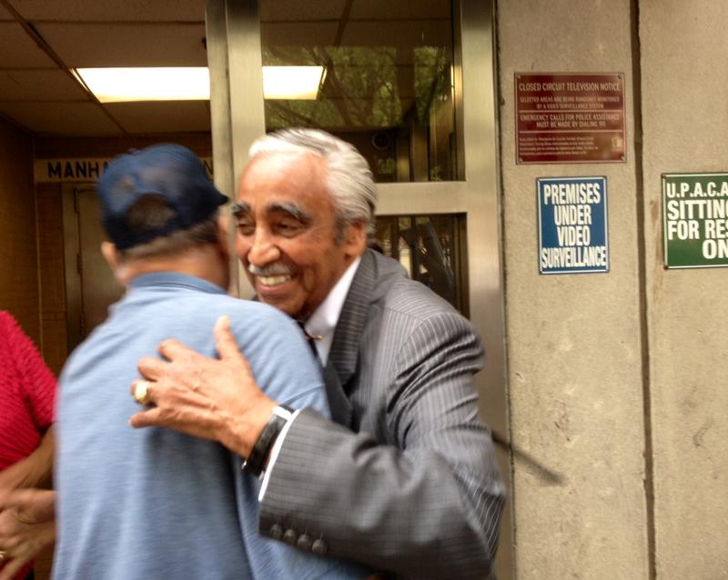 Rep. Charles Rangel embraces a supporter at a senior center in East Harlem