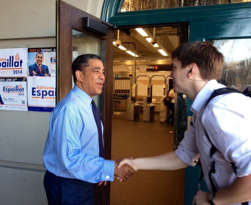 Sen. Adriano Espaillat shaking hands with voters outside the Dyckman Street subway station