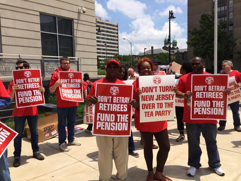 Workers protest Governor Chris Christie's planned pension cuts