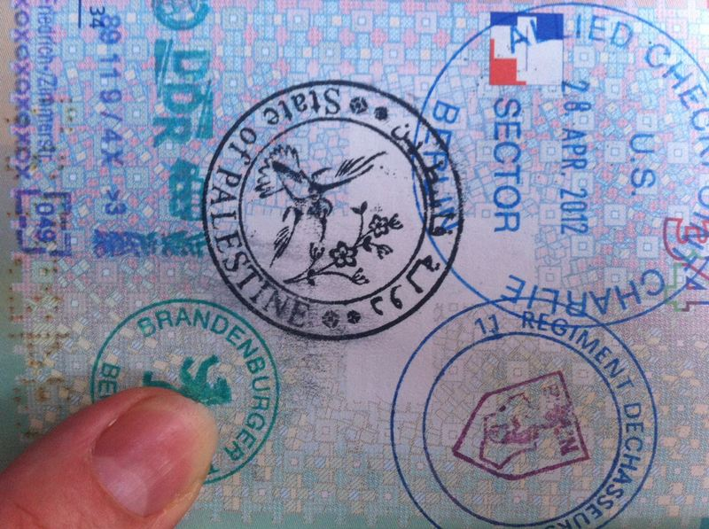 """For his project """"Live and Work in Palestine,"""" Khaled Jarrar designed a seemingly official Palestinian passport stamp."""