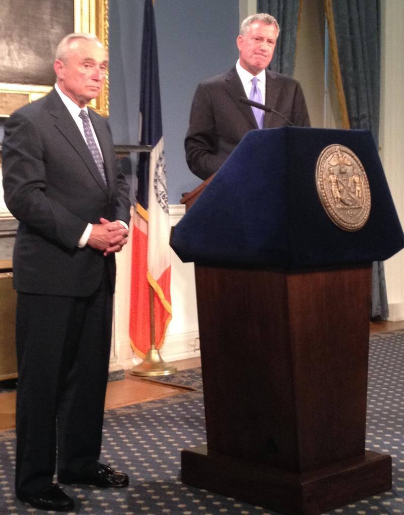 Police Commissioner Bratton and Mayor de Blasio speaking to reporters at City Hall.