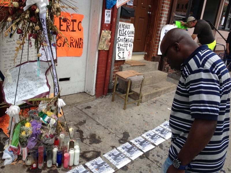 A Staten Island man studies a memorial for Eric Garner in Tompkinsville, Staten Island.