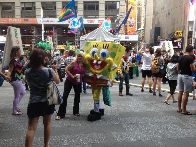 Tourist Poses With SpongeBob SquarePants In Times Square
