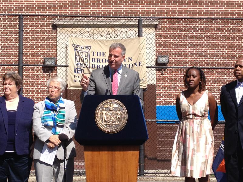 Mayor de Blasio and Schools Chancellor Fariña (left) announce the city's results on state test scores for 2013-2014 school year outside a school in Bedford Stuyvesant.