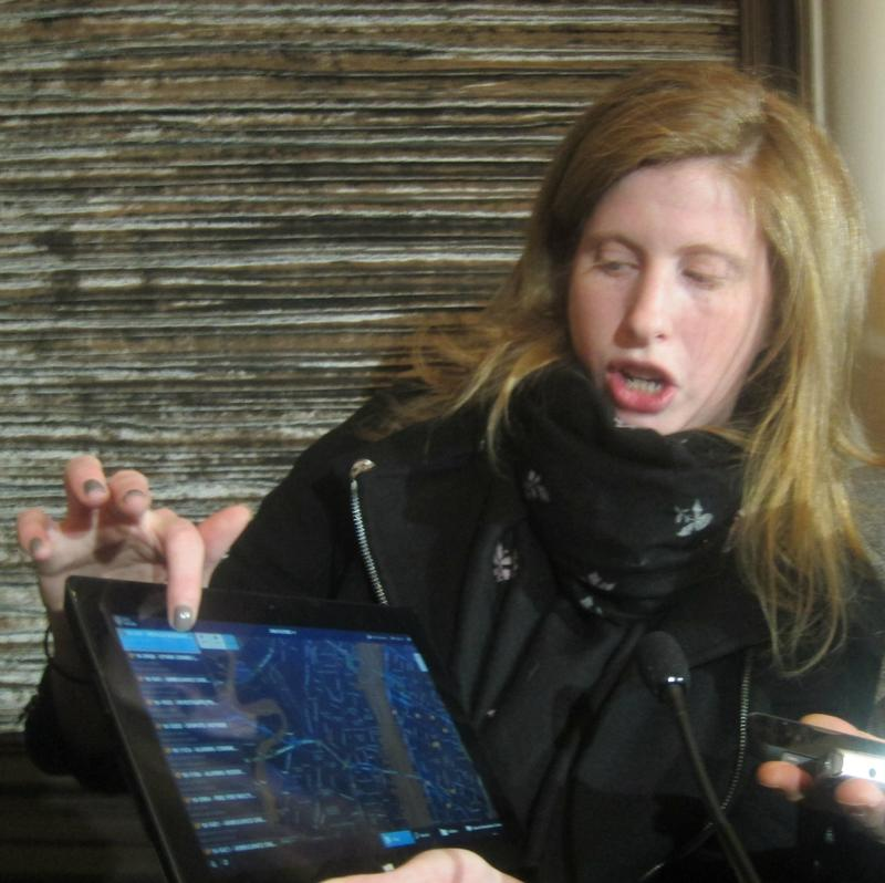 Jessica Tisch, the NYPD's Deputy Commissioner of Information and Technology, demonstrates what the new tablet computer might do.