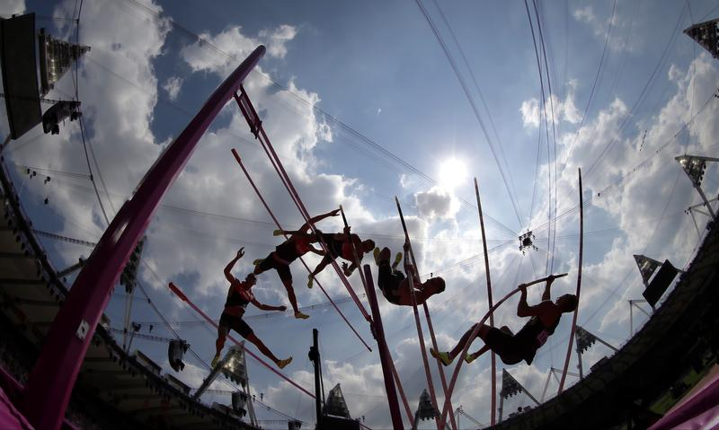 In this multiple exposure photo, Germany's Pascal Behrenbruch competes in the men's decathlon pole vault during the athletics in the Olympic Stadium at the 2012 Summer Olympics, London.
