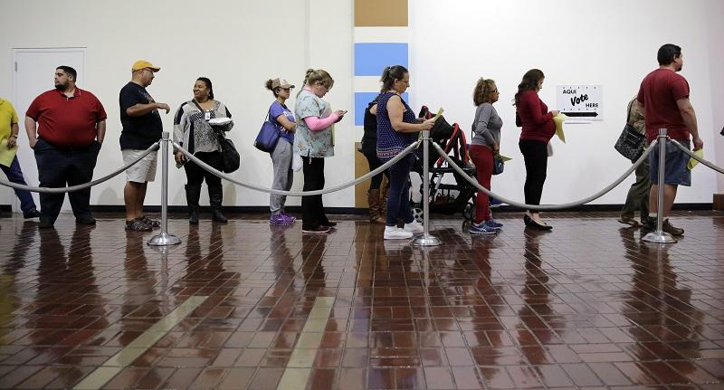 Voters wait in line to cast ballots at an early polling site, Friday, Nov. 4, 2016, in San Antonio. Friday is the last day of early voting in Texas. The polls will reopen on Election Day, Nov. 8.