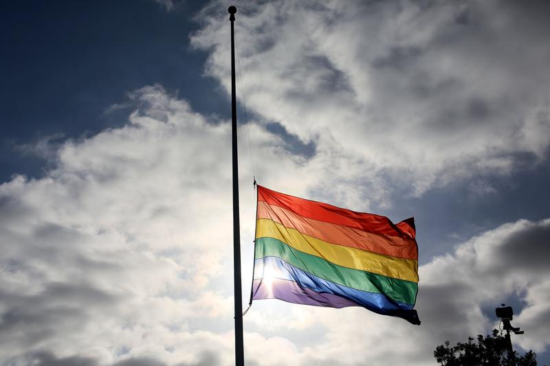 A pride flag stands a half mast during a memorial service in San Diego, California on June 12, 2016, for the victims of the Orlando Nightclub shooting.