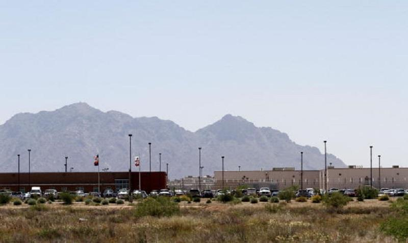 Vehicles parked outside the La Palma Correctional Center in Eloy, Arizona, on May 11, 2010. La Palma, which houses about 2,900 convicts from CA, is one of 65 facilities operated by Corrections Corp.