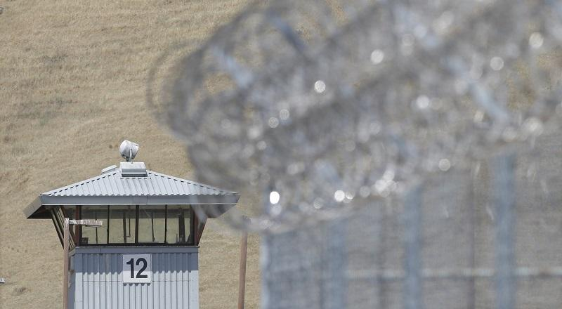 In this photo taken Wednesday May 20, 2015, a guard tower and razor wire are seen at California State Prison, Solano in Vacaville, Calif.