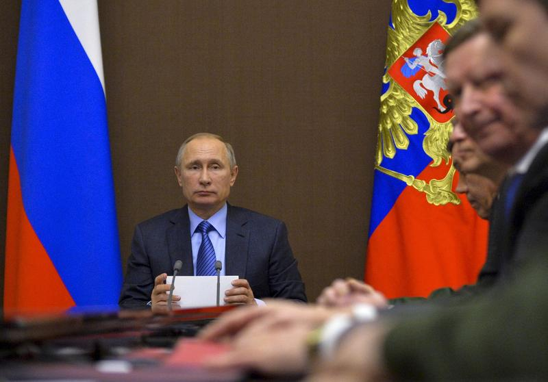 Russian President Vladimir Putin chairs a meeting on military issues in the Bocharov Ruchei residence in the Black Sea resort of Sochi, Russia, Friday, Nov. 18, 2016.